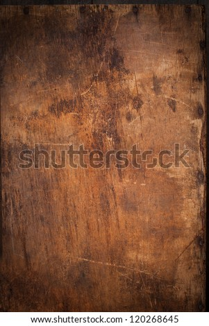 Old Wooden Panel with the Hammered Rusty Nails on the Edge