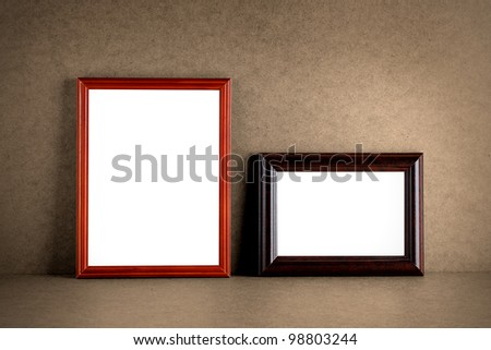Old wooden photo frames on grunge background