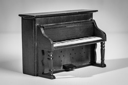 Old wooden piano from a dollhouse