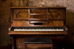 Old wooden piano keys on wooden musical instrument in front view