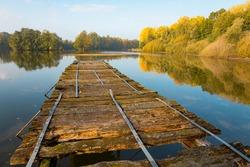 Old wooden pier at a lake in Münsterland, Westphalia, Germany