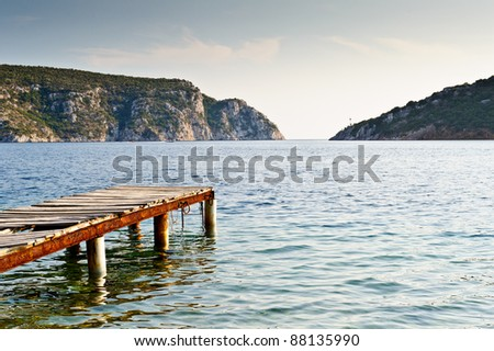 Old wooden pier, beautiful bay - stock photo