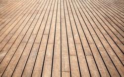 Old wooden pier floor perspective. Background photo texture