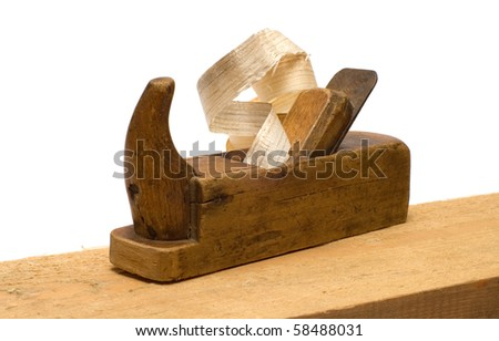 Old wooden plane with the chips on the board isolated on a white background.