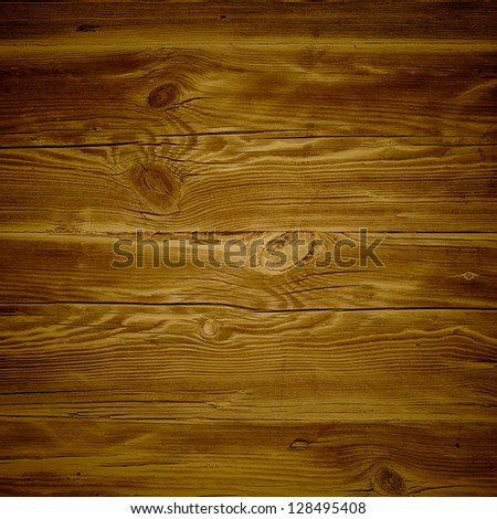 Old wooden planks cracked by a rustic background