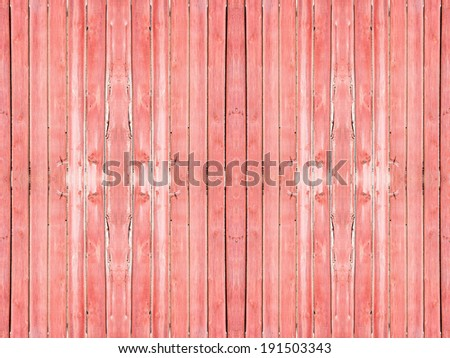 Old wooden planks painted with pink paint cracked by a rustic background