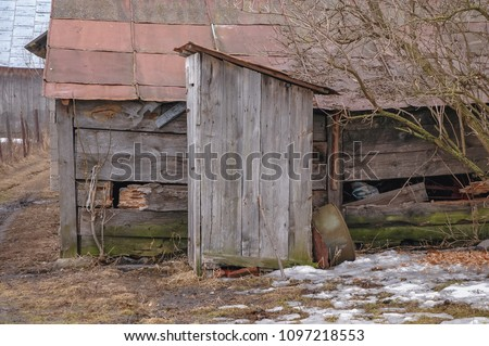 Old wooden privy in a small village in Masovian Voivodeship of Poland