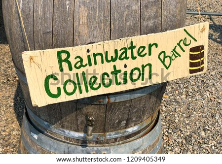 Old wooden rainwater collection barrel for storm runoff on an old farm