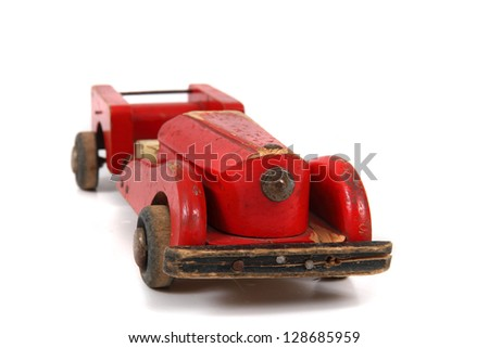 old wooden red car toy isolated on the white background