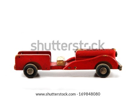 old wooden red toy car isolated on the white background