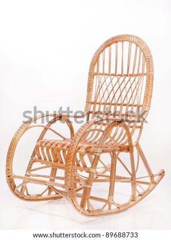 Old wooden rocking chair over white background