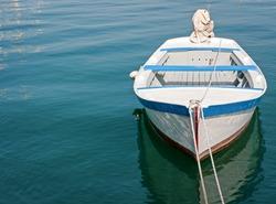 old wooden rowboat at a lake