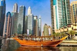 Old wooden ship, Dhow cruise in Dubai Marina, Dubai, United Arab Emirates