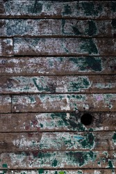 Old wooden slats painted green background