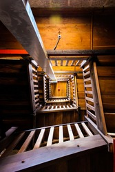 Old wooden spiral stairway to top of the tower. Beautifull architecture with modern parts.