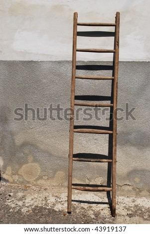 Old wooden stair against the wall of a old house