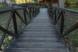 Old wooden staircase leading down, horizontal photo, park staircase with steps and railings
