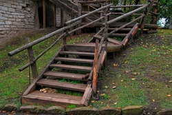 old wooden staircase leading up to the courtyard of a medieval castle