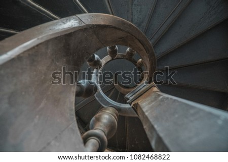 Old wooden staircase shaping a beautiful spiral