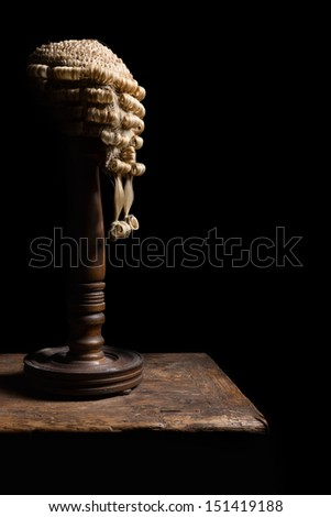 Old wooden stand with an authentic horsehair judge's wig