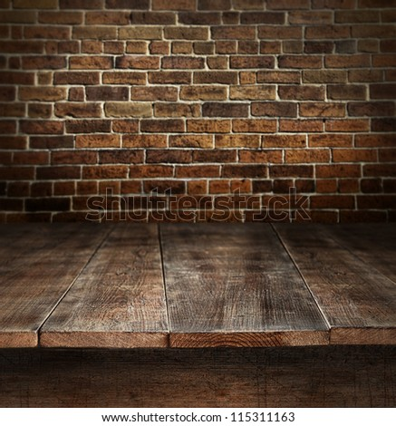 old wooden table with brick...