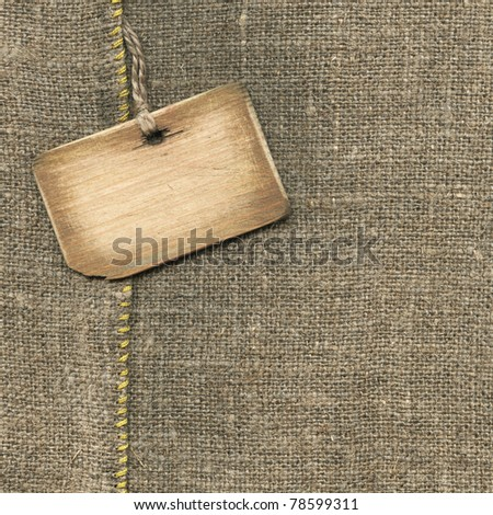 Old wooden tag on the sacking