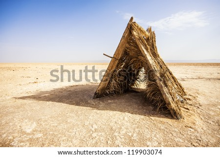 Old wooden tent in the salt lake of Chott El Djerid, Tunisia.