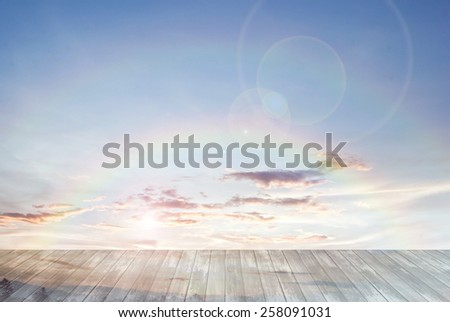 old wooden texture and double twin rainbow with lens flare in blue sky background