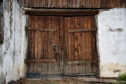 old wooden textured big doors, old wall with big vintage gates, brown beautiful textured wooden old gates of cowshed
