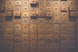 Old wooden textured drawers background in chinese herbal medicine shop in china.Old Vintage style asian objects.