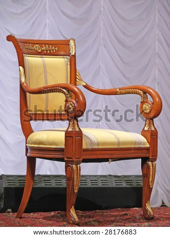 Old wooden throne in opera house.