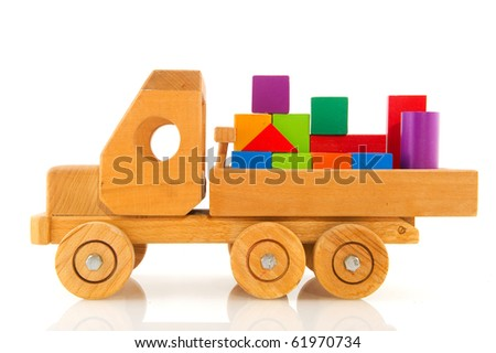 Old wooden toy car truck with colorful blocks