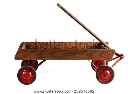 Old wooden toy wagon isolated on white.