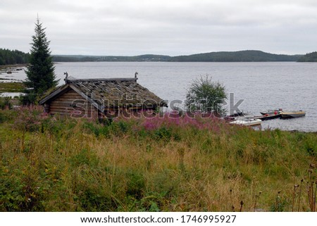 Old wooden traditional pomor house on the bank of Keret river. Keret village, Republic of Karelia, Russia. Stock fotó ©