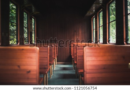 Old wooden train seats in this unused carrage