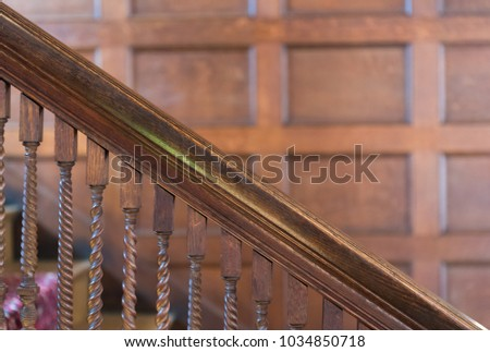 Old wooden twisted stairs railing in a house