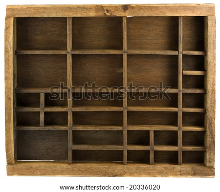 Old wooden typesetter case (drawer) isolated on white