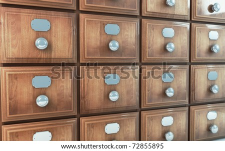 old wooden vintage drawer cabinet - stock photo
