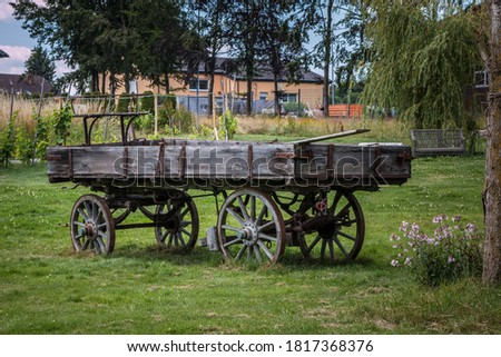 Photo of  Old wooden wagon for horses or cattle to transport things