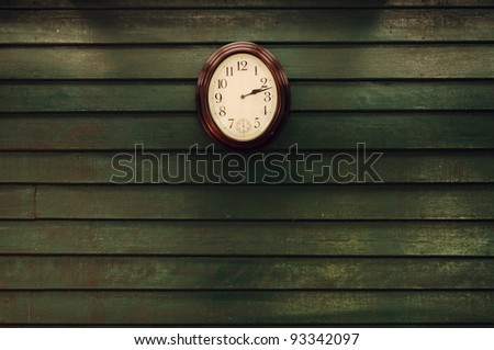 Old wooden wall with clock