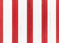 Old wooden wall with pattern of red and white stripes. Seamless background photo texture
