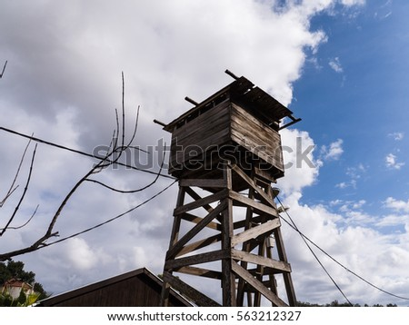 Old wooden watch tower. #563212327