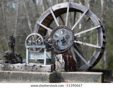 Old wooden water wheel and electric generator set