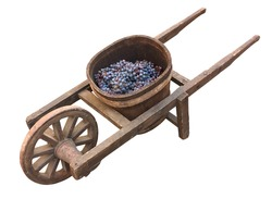 old wooden wheelbarrow with vat for grape transport - ancient tool for wine production