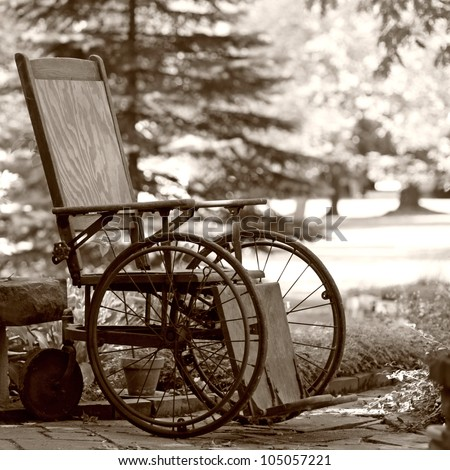 old wooden wheelchair sits...