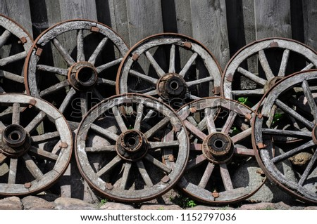 Old wooden wheels #1152797036
