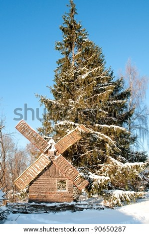 Old wooden wind will covered with snow - stock photo