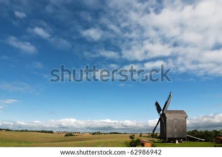 "Old wooden windmill near Storkow in Mecklenburg-Vorpommern, Germany. This kind of windmill is calling ""Paltrock-Windmill""."