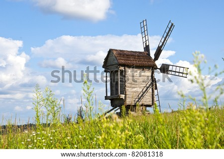 Old wooden windmill on the field