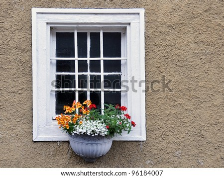 Old wooden window decorated with flowers